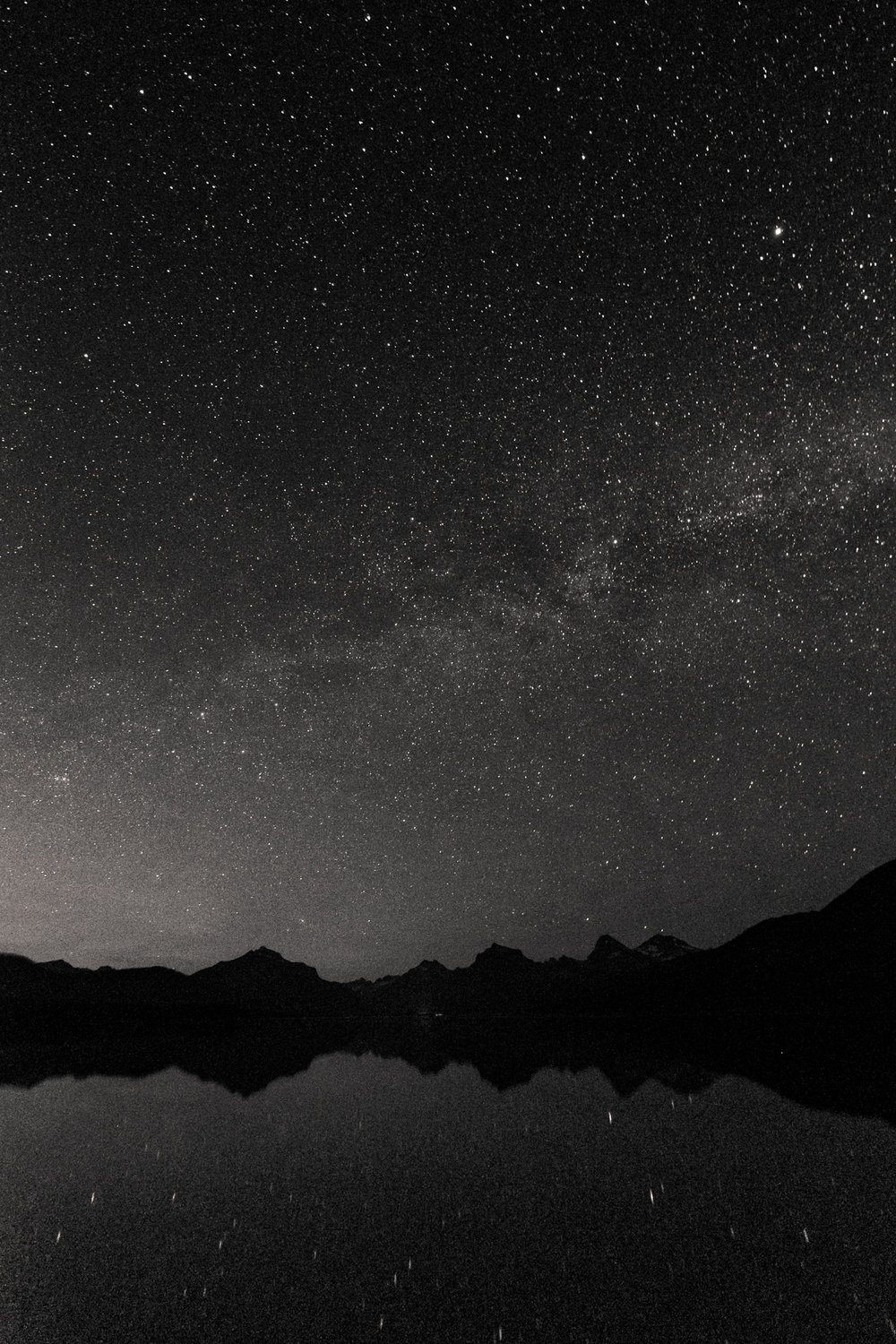 My first photo of the night, of the Milky Way floating over Lake McDonald and the distant mountain ranges.  Fujifilm X-T1 ,  10-24mm f/4 lens . 30 seconds, f/4, ISO 6400.