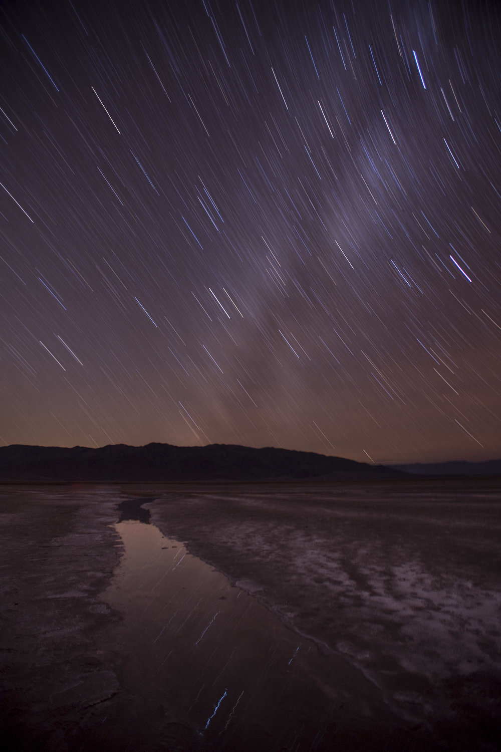 In the very dark skies of Death Valley National Park, I found a bright star in live view and used a  Hoodman HoodLoupe  to fine-tune the focus manually. Nikon D5 with a Nikon 17-28mm f/2.8 lens. 20 minutes, f/2.8, ISO 100.