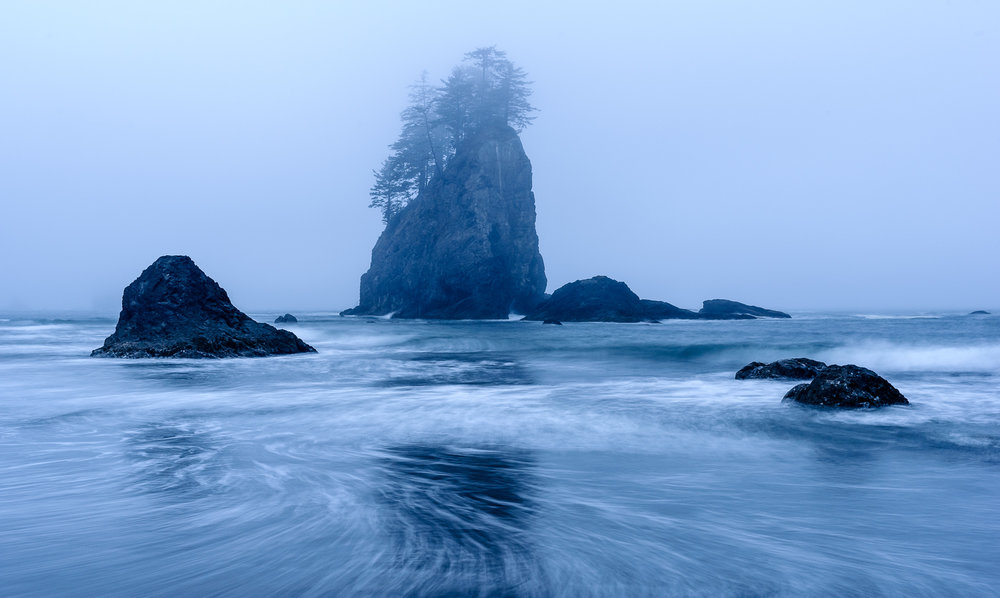 During a recent National Parks at Night (@nationalparksatnight) workshop in Olympic National Park, we got some stunning fog to shoot in at dusk at Second Beach. Creating this image was a process of setting up a composition with the sea stacks, finding an exposure with a shutter speed long short enough to maintain detail in the water but long enough to compress time, and waiting for the waves to wash ashore in aesthetically pleasing ways. Not to mention having a bunch of fun being in a beautiful place. 2 seconds, f/11, ISO 200.