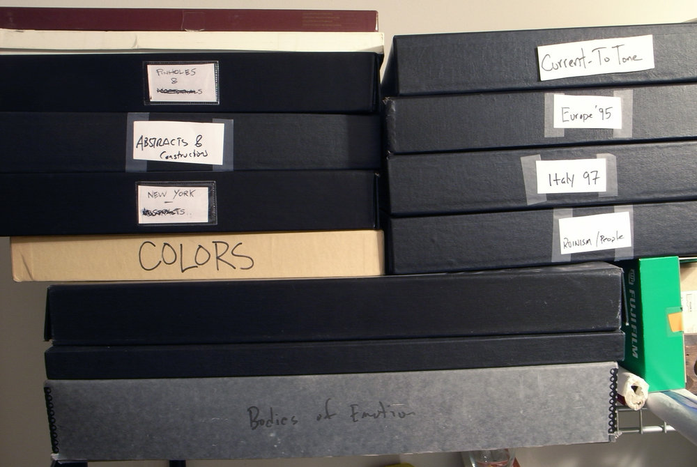 My final prints are stored in archival boxes, organized by theme/subject matter.