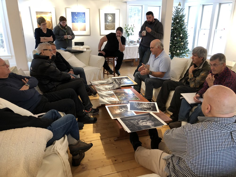 "Poring over prints during John Paul Caponigro's ""B&W Mastery"" class."