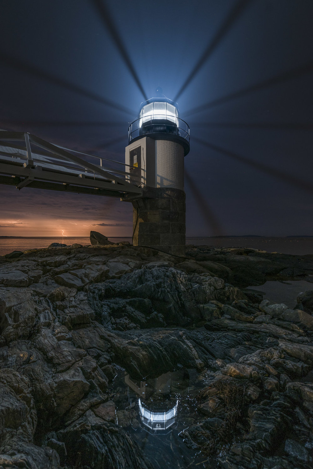 Marshall Point Lighthouse, Port Clyde, Maine. Nikon D750,  Tamron 15-30mm f/2.8  lens at 15mm. 110 seconds, f/4, ISO 400 for the foreground, plus a second exposure at 20 seconds, f/4, ISO 100 for the lighthouse. Light painted with a Luxli Viola at about 20 percent brightness, swept across the foreground to illuminate the dark rock.