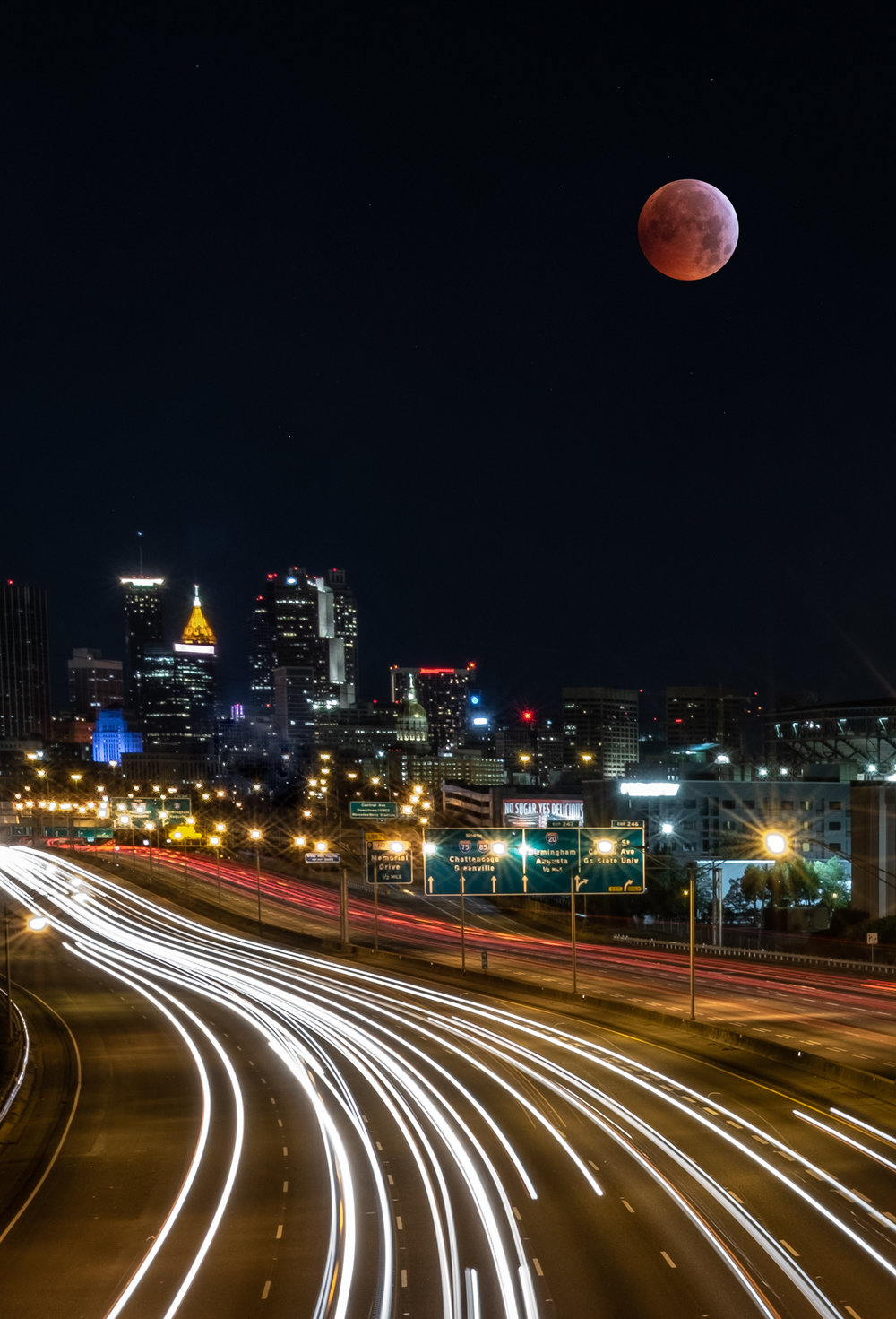 The 2019 super blood wolf moon (aka the lunar eclipse) over Atlanta. Foreground: 35mm lens, 25 seconds, f/16, ISO 200; background (moon): 600mm lens, 1/2 second, f/5.6, ISO 3200.