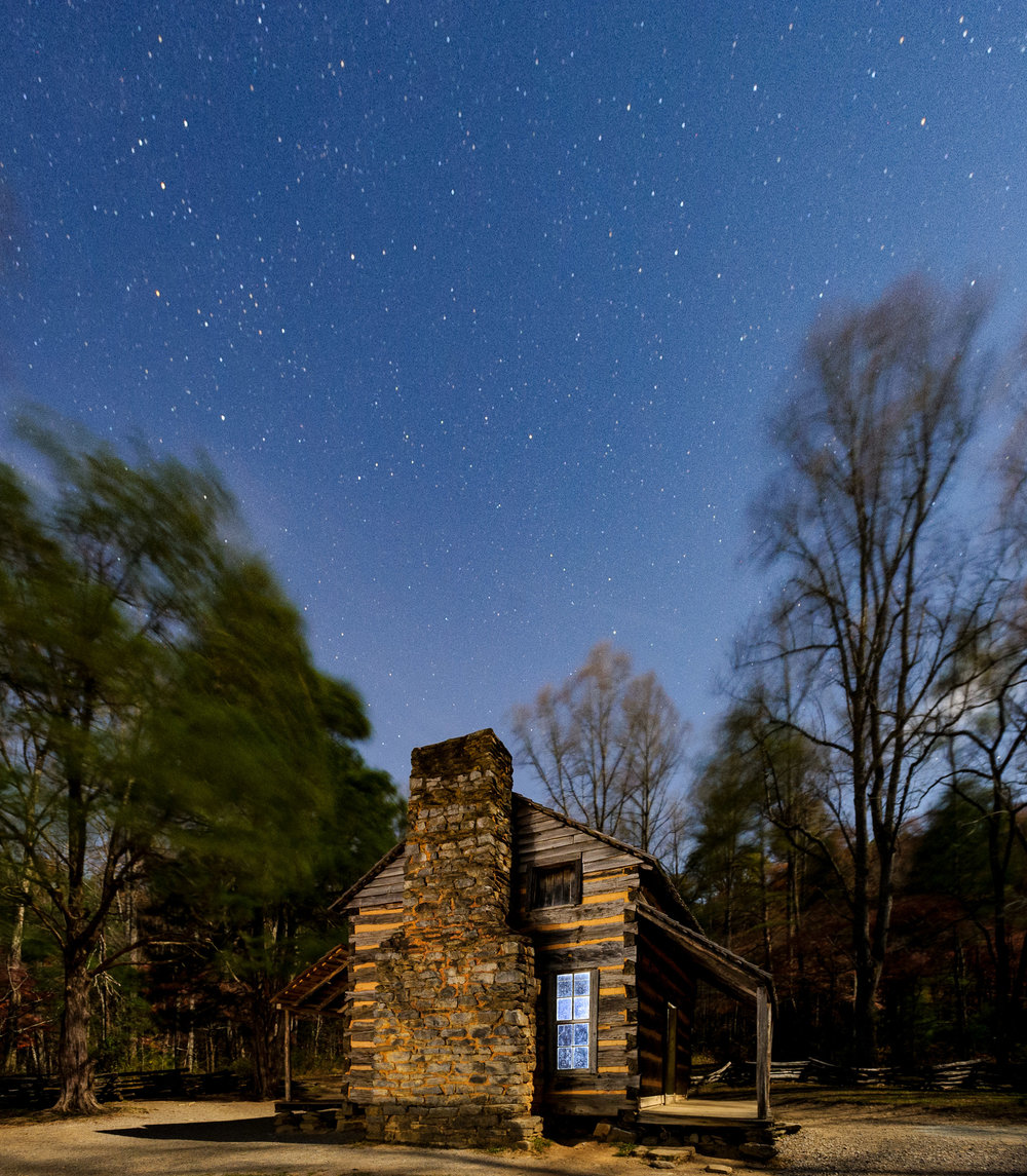 The Oliver Cabin is one of the many wonderful night photography subjects in  Great Smoky Mountains National Parks ' Cades Cove region. Cades Cove is closed to vehicles at night, but you can walk or bike the 11-mile loop road all night if you'd like. © 2017 Chris Nicholson. Nikon D3s, 17-35mm f/2.8 lens, light painted with a  Coast HP7R  flashlight. 30 seconds, f/5.6, ISO 3200.