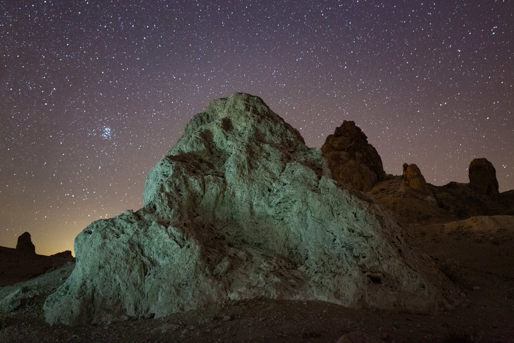 Figure 1. Trona Pinnacles, California. November 2014. Canon 5D Mark II with a Nikon PC Nikkor 28mm f/3.5 lens. 30 seconds, f/8, ISO 6400. White balance: tungsten. Foreground lighting with a Four Sevens Quark 123 LED flashlight. Sky glow from mostly sodium vapor lights in the nearby small city of Ridgecrest.