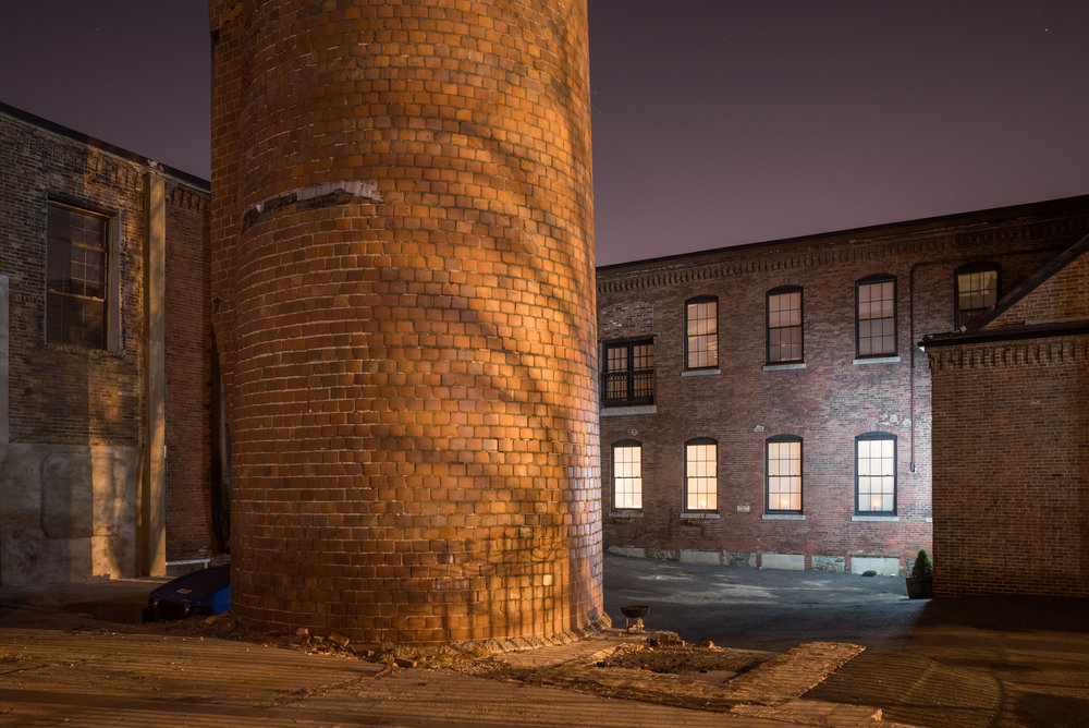 Figure 3a: Pawtucket Textile Mill. December 2015.  Nikon D750  with a Nikon PC Nikkor 28mm f/3.5 lens. 10 seconds, f/8, ISO 400. White balance neutralizing the metal halide light: 3100 K, +15 Magenta.