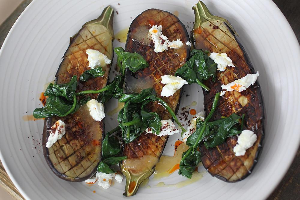 In Concord, Saltbox Kitchen's roasted eggplant with braised spinach, goat cheese, honey, and sumac.     Photo Credit: Suzanne Kreiter/Boston Globe Staff
