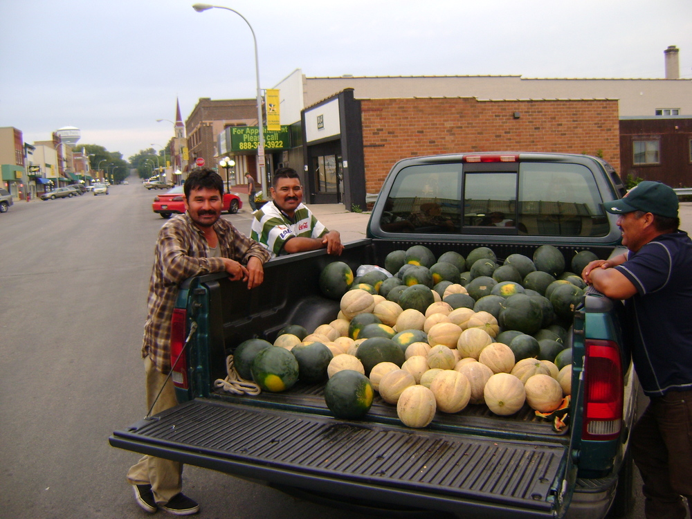 Farmers from Agua Gorda Cooperative Farm with their melon harvest