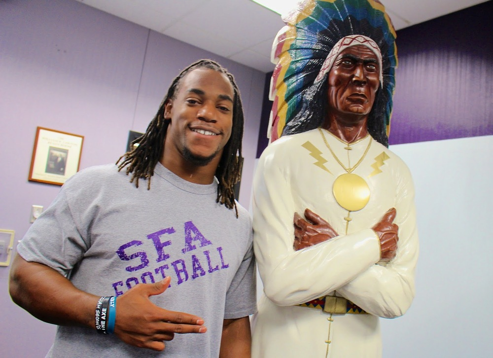Gus Johnson posing next to Chief Caddo after SFA landed FCS bid Nov. 14 (EB)