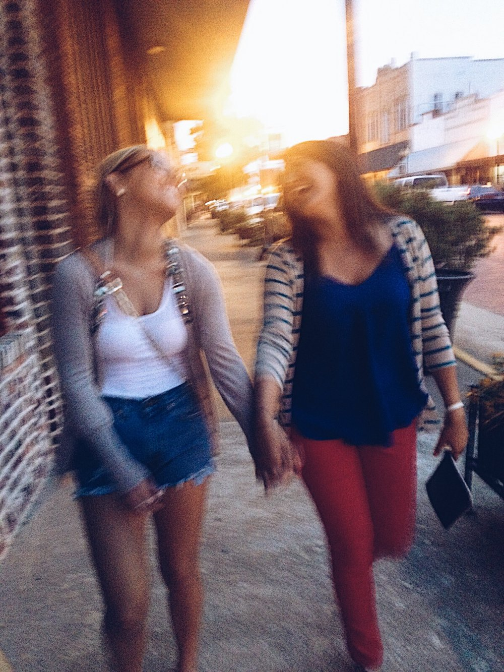 2012 - Blurry picture, priceless memory. Summer nights strolling through downtown Nacogdoches. This night, in particular, we were on our way to watch the fireworks on the Fourth of July.