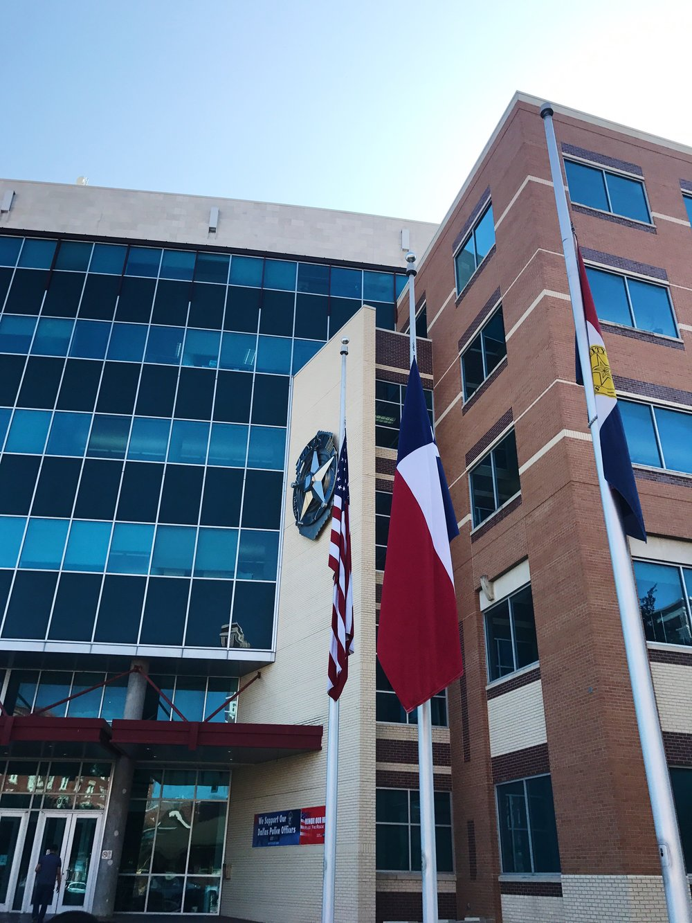 Flags fly at half staff in front of DPD headquarters