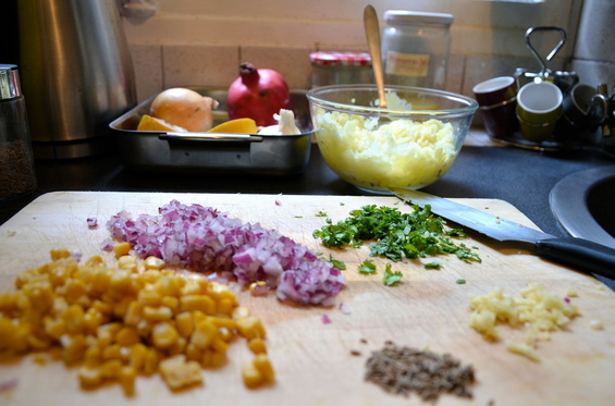 -finely dice your onion, coriander, and garlic to create your filling. peel your potatoes and mach in a bowl and add salt
