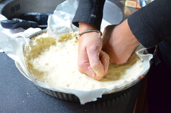3. Place parchment paper in your pan and add in crust mixture. Start to mold mixture into the pie pan with your hands. Freeze for 30 mins and preheat oven to 140C/ 280F