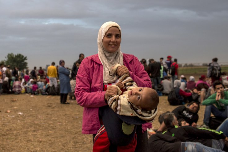A migrant woman and her child