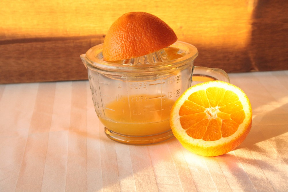 'Flu Shot' Cocktail - oranges being juiced