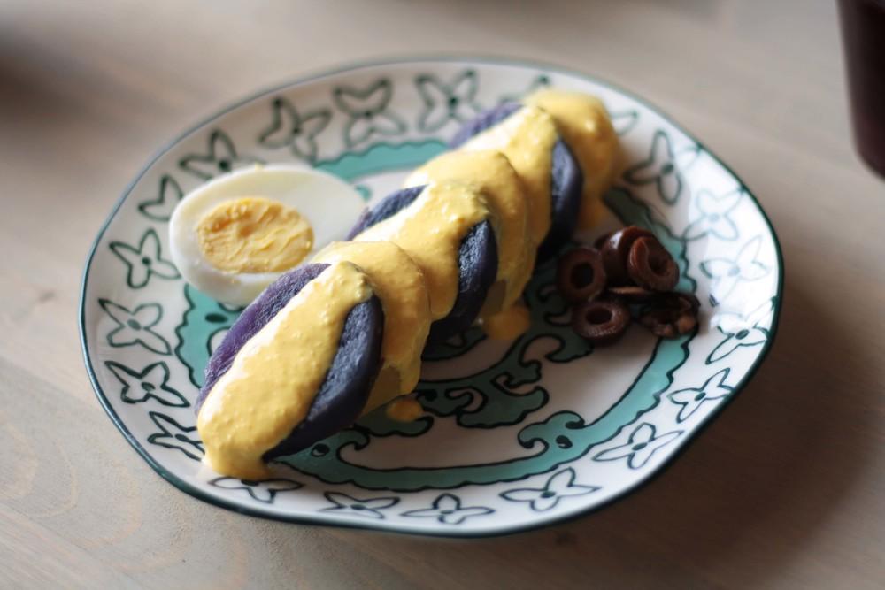 Papa a la Huancaína with purple potatoes and chicha morada