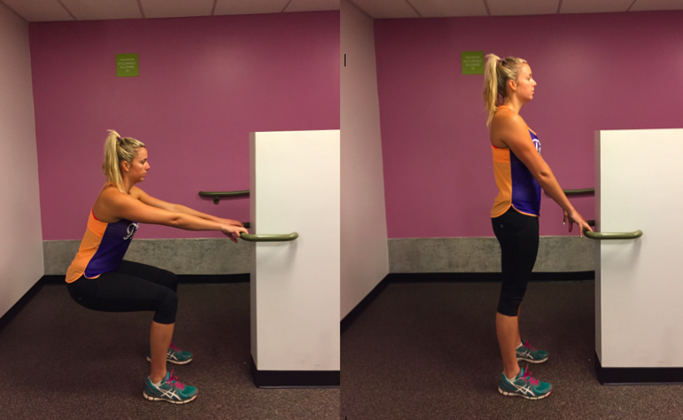 Performing a supported squat using the rail to prevent falling backwards and to promote a backward sitting action through the hips.