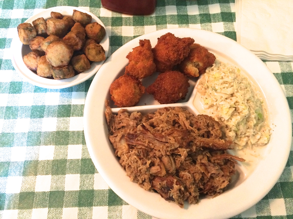 I'm not one for food shots, and this one is pretty piss poor,but I felt y'all had to see this pile of pork and them hushpuppies
