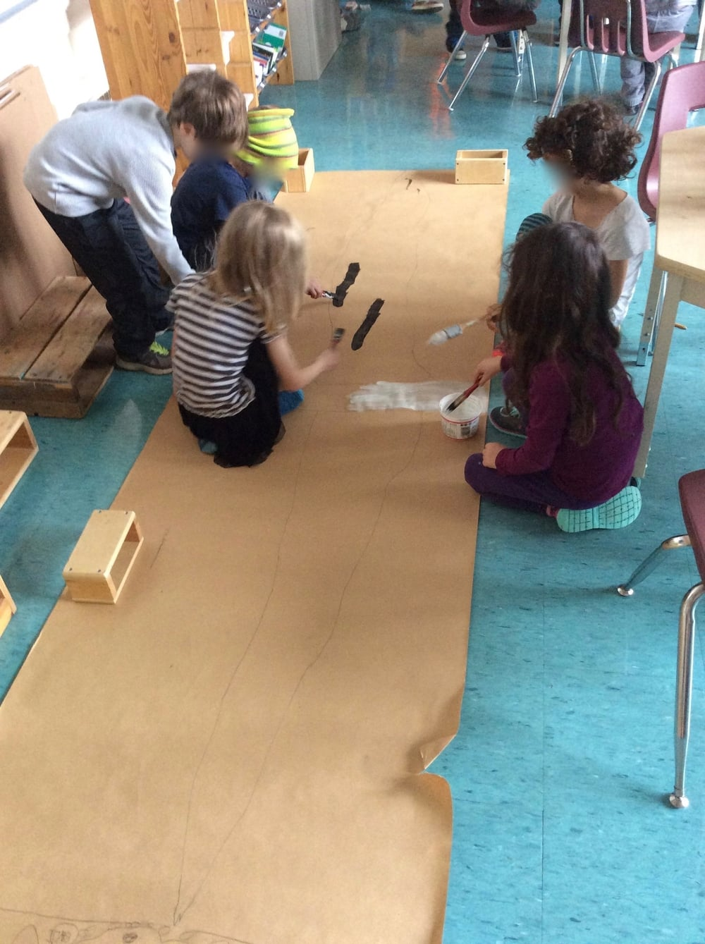 A group of students measured the wingspan of a wandering albatross (300cm), then painted the wings on mural paper.
