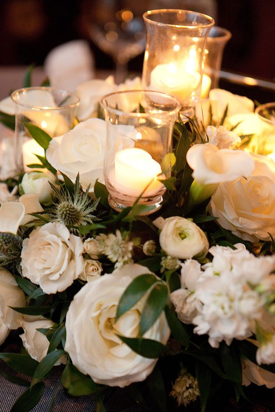 No room for candles? No problem, we can place them into your table flowers.