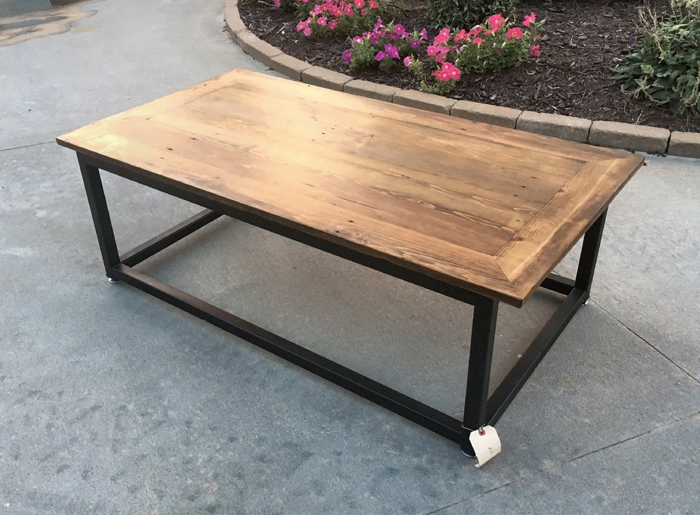 "Bring Rustic Charm to your home decor. The Brick Layers Coffee Table will add ruggedly sophisticated appeal to your living room furniture. The solid wood top has been cleaned and sealed, yet bears the nicks of time and the patina of use. The frame is a hand-welded 1 ½"" steel base with a black satin finish. This coffee table blends reclaimed wood and iron into a timeless vintage modern piece. This coffee table is crafted of artfully distressed pine, so no two tables are ever exactly alike. Bring the lasting beauty of this bold living room accent to your home décor.    dimensions: 55"" long x 29"" wide x 17"" tall...$550.00"