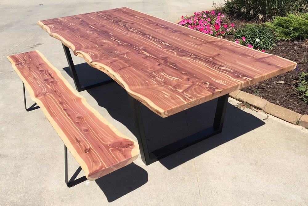 "Red Cedar Live Edge Dining Room Table with Bench 42"" W X 96"" L X 28"" T.   This 2"" thick table is supported by 2"" X 3"" rectangular steel tapered...$3,200.00  SOLD"