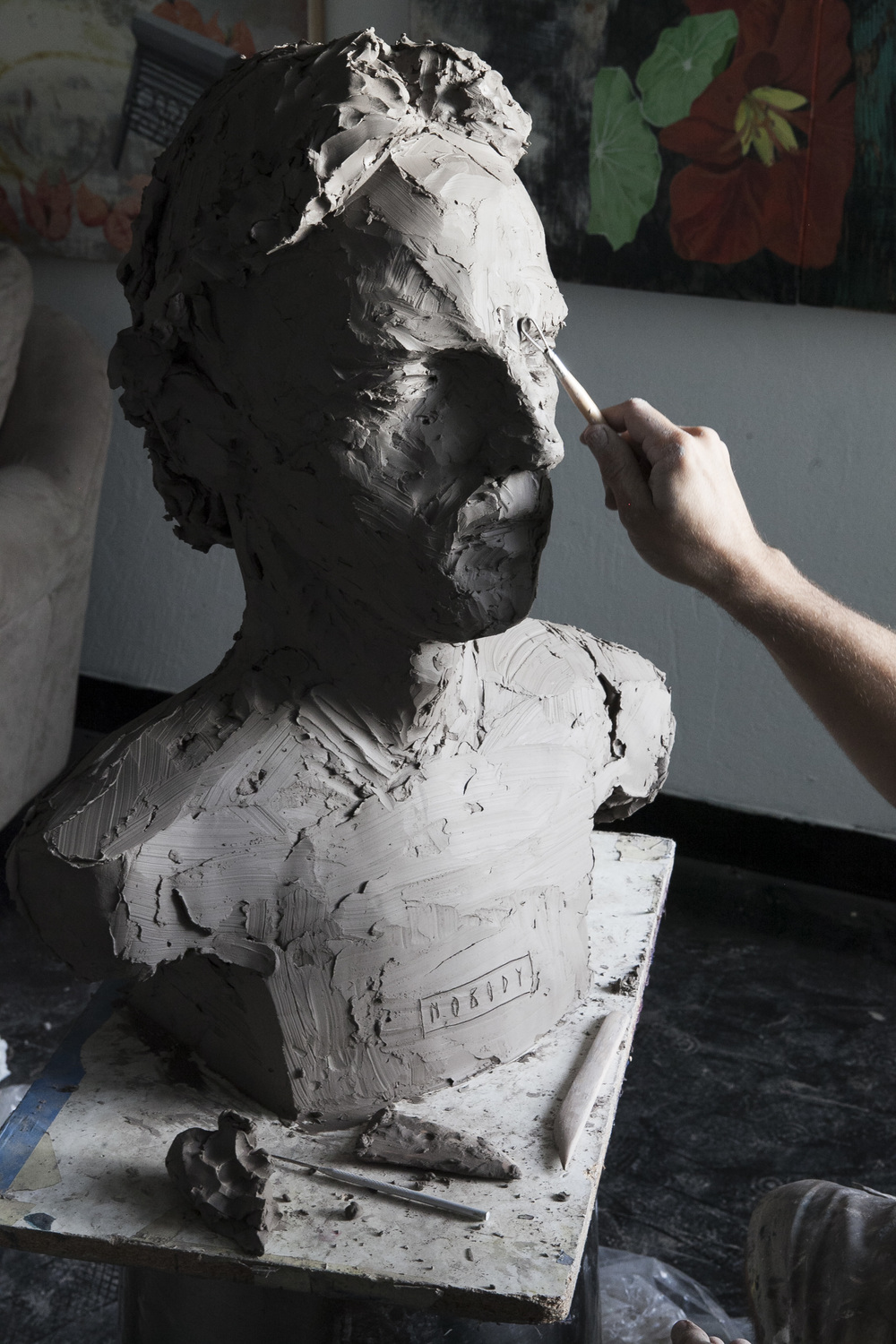 Axel Void working on the bust of Alvie Morris that will be cast in cement.