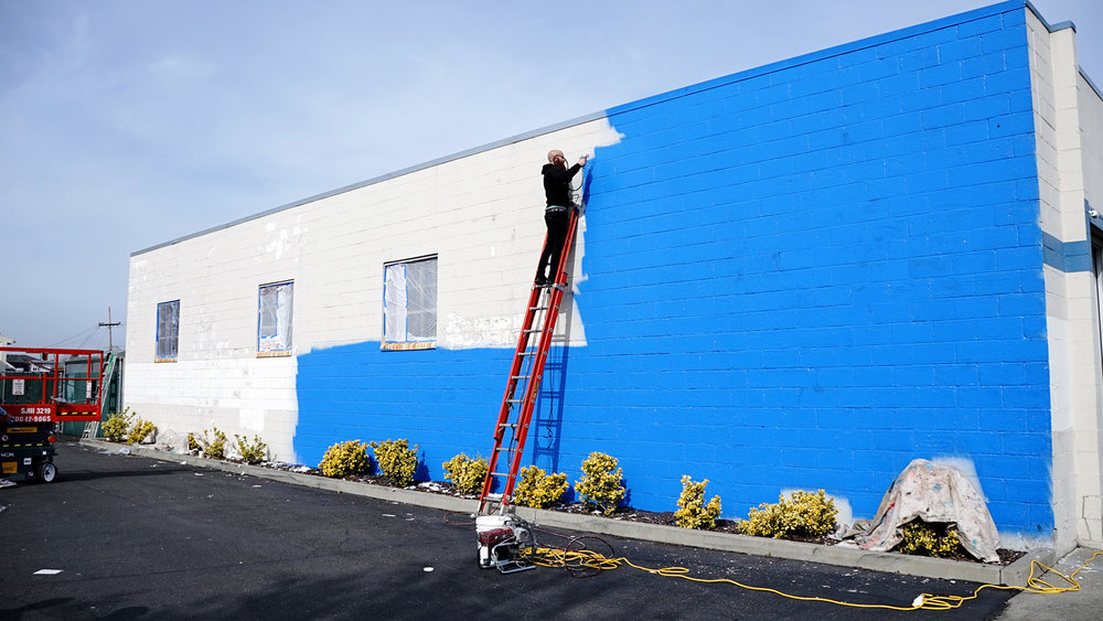 Ernest Doty helping with the background blue.