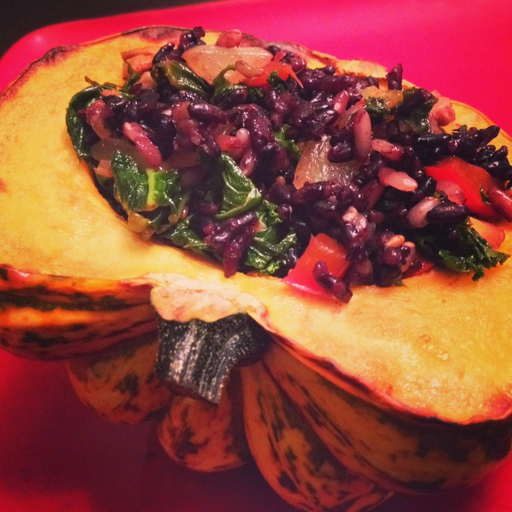 Roasted kabocha squash stuffed with forbidden black rice, wild rice, kale, onions, red bell peppers and shiitake mushrooms.