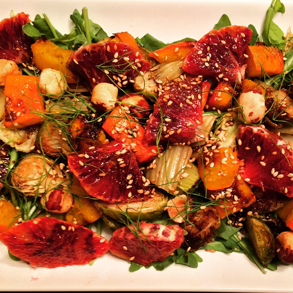 Roasted pumpkin squash, fennel, brussels sprouts, blood oranges and hazelnuts mixed over a bed of arugula.