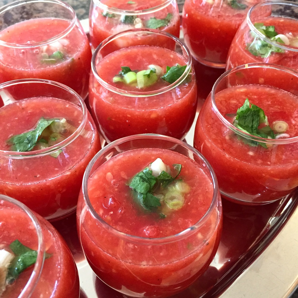 Watermelon gazpacho shooters- a cool, sweet and tangy appetizer made with watermelon, tomatoes and cucumber topped with a scallion relish.