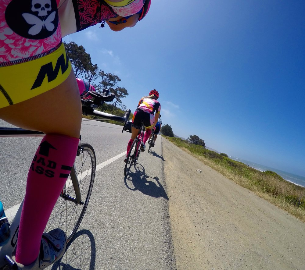 Coast rides with fellow teammate Jessica Frazier.