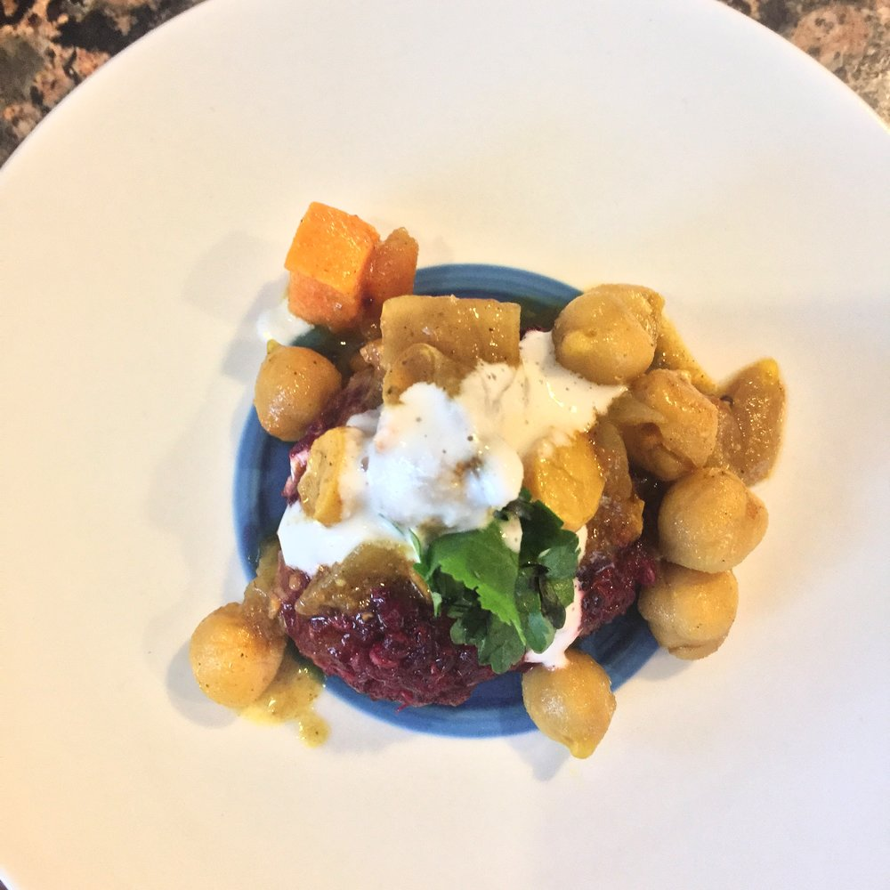 Beet and quinoa tikki topped with chana masala, cashew cream and cilantro.