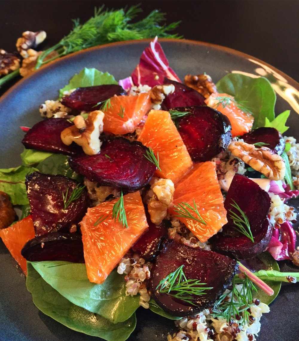 Roasted beets, cara cara oranges with rainbow quinoa and topped with dill and walnuts.