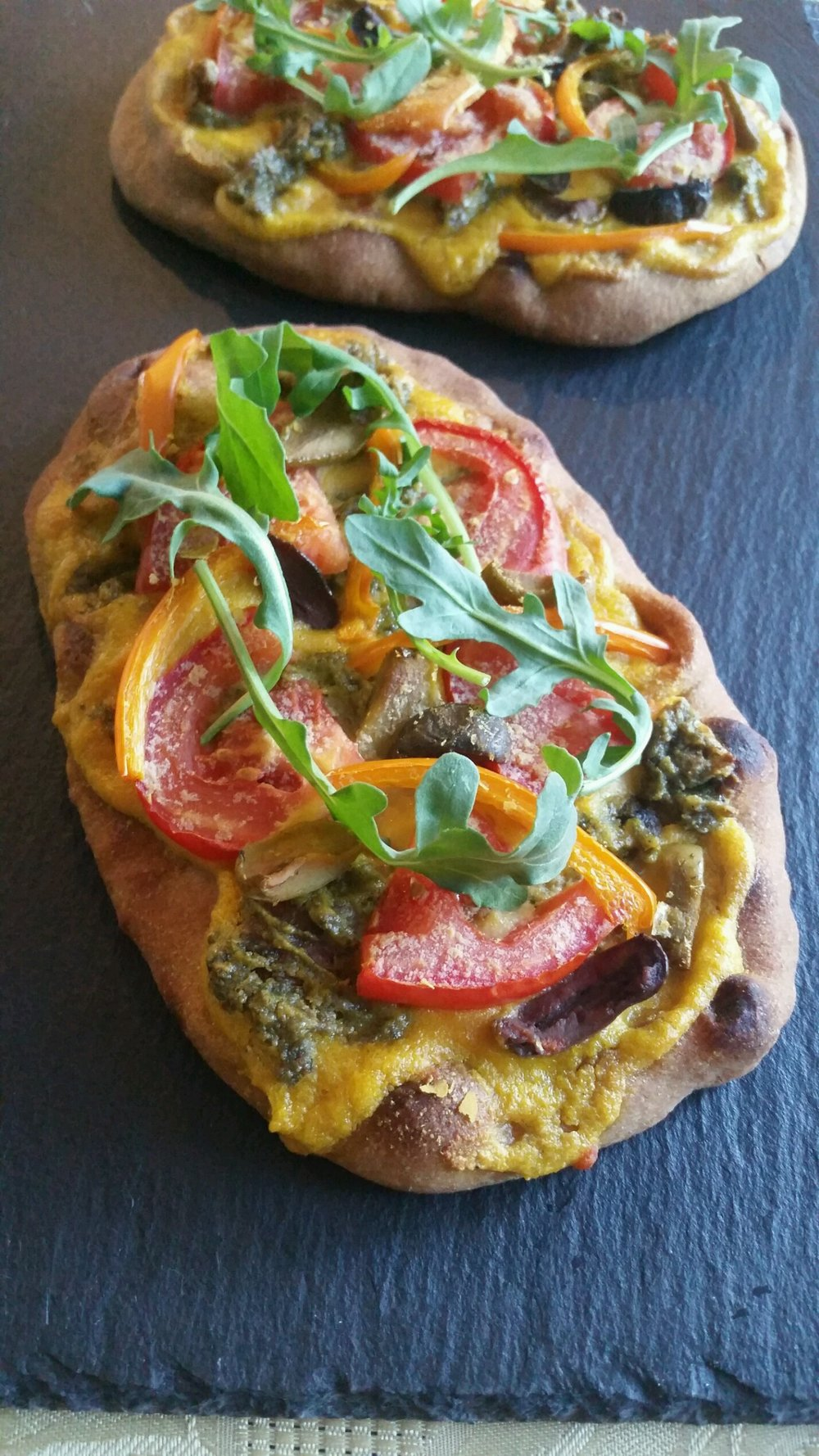 Vegetable pizza naan using cashew cream. This cheese is so versatile!
