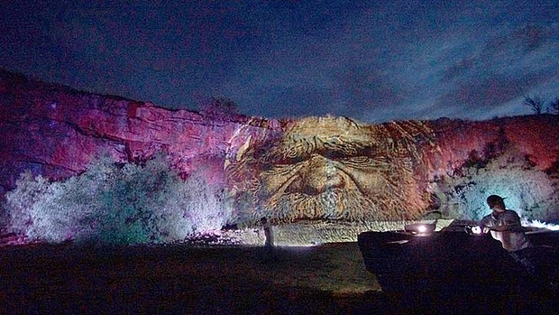 Images are projected on the wall of a quarry in Dookie, Victoria. Photo: Serana Hunt
