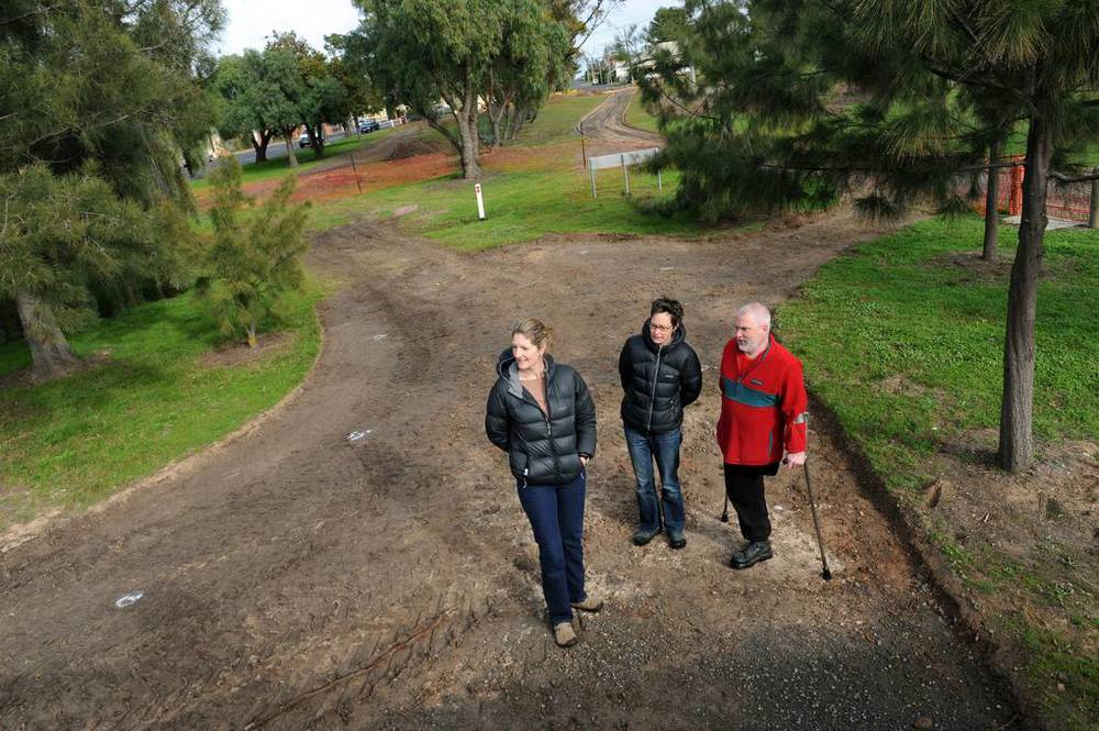 TRANSFORMATION: Natimuk Verj project manager Carolynne Hamdorf and Horsham Rural City community development officer Melissa Morris and community facilitator Martin Bride inspect works at Natimuk's Main Street. Picture: PAUL CARRACHER