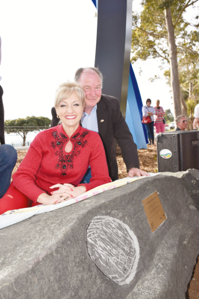 "Nestled amongst the Bower roadside sculpture to Neerim South, Arts Minister Heidi Victoria, who officially opened the ""Bower"" on Saturday, with Neerim District Progress Association president Neville Cousins."