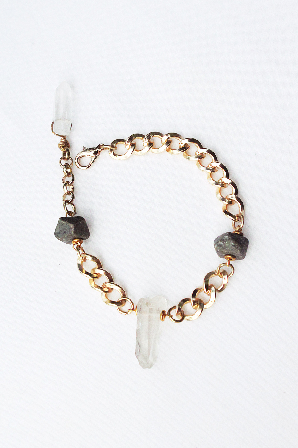 Raw quartz crystal with faceted pyrite beads