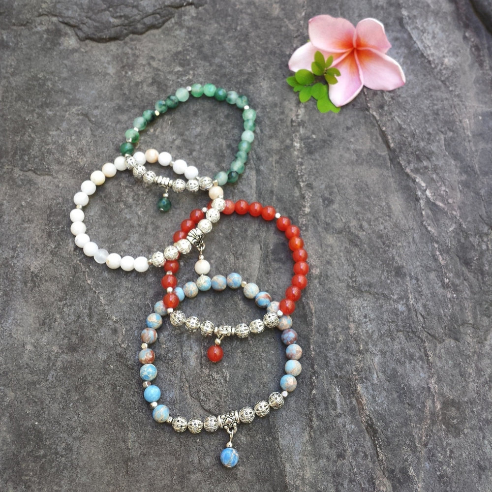 From top to bottom, the Fibonacci bracelet in Green Aventurine, White Quartz, Red Carnelian and Blue Magnezite