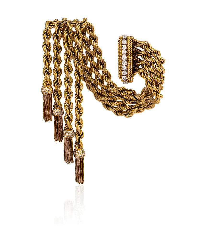 "Van Cleef & Arpels, France.  ""Cordes Ludo"" bracelet with diamond capped tassels, in 18K. Circa 1951."