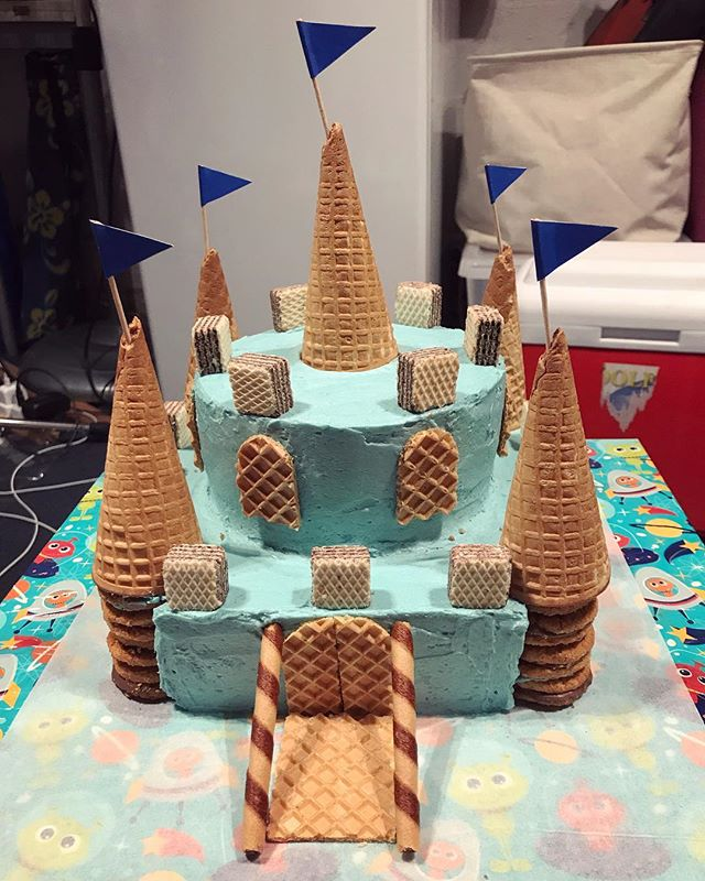 The brief this year was a castle cake with blue icing for my #almostfive year old. #birthdaycake #castlecake #bluecake #wafers #kidsinthekitchen #bakingwithkids #cookingwithkids #baking #wholefoodbaking #betterbuttercream