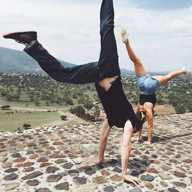 Story of my life: visit a new place, do a handstand. Made more complicated by dresses and uneven surfaces and ice and public staring but not a deterrent. Throw back to upside down on the Pyramid of the Sun with @n8training. Who else can't help themselves?