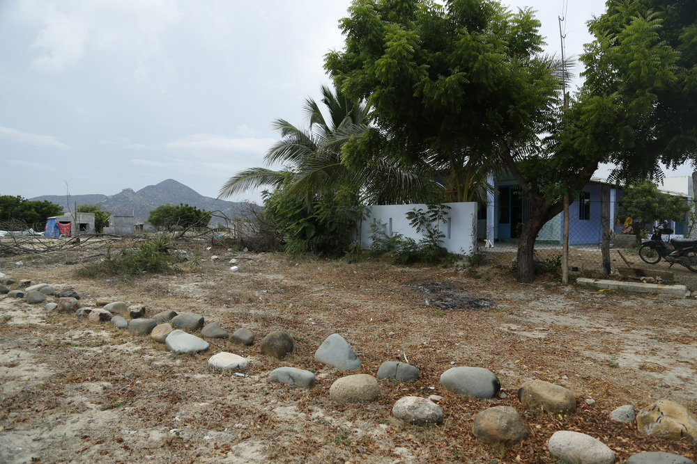 Houses are built in the area of cemetery. They remove the stones to built houses on top.