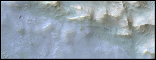 500 meters wide image of deposits rich in chloride (cyan) and clays (yellow) on Mars (HiRISE, from Ruesch et al., 2012).