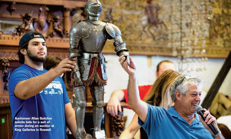 Auctioneer Allan Baitcher solicits bids for a suit of armor during an auction at King Galleries in Roswell.