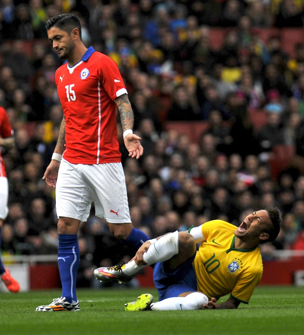 Neymar, Brazil soccer player, injured during the match against Chile; UK. ©Erica Dezonne / All rights reserved
