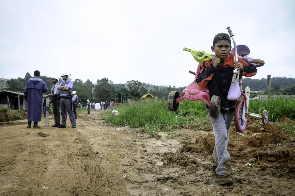 A boy is forced to live home after police take control of the area; Brazil. @Erica Dezonne / All right reserved