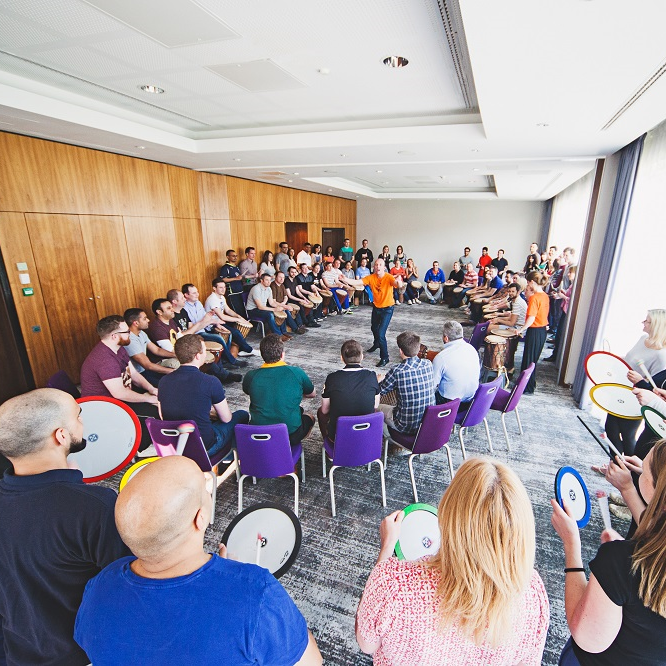 Grand drum circle session for a conference finale.