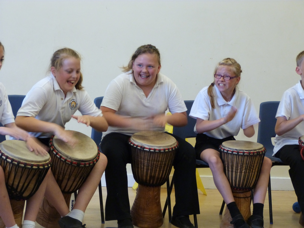 Primary school students enjoying an Unbeatable Energy African drumming workshop - Chapel en le Frith, Derbyshire